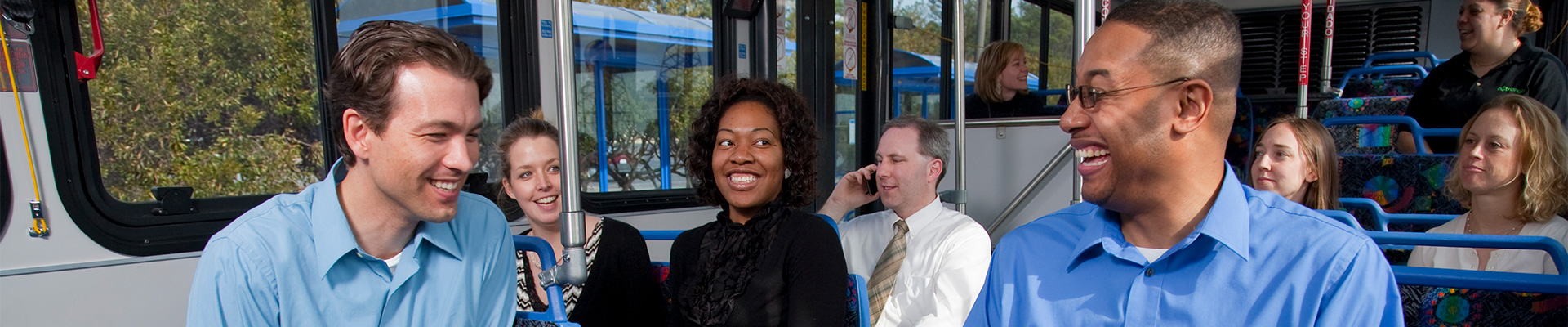 Riders laughing and talking onboard the bus