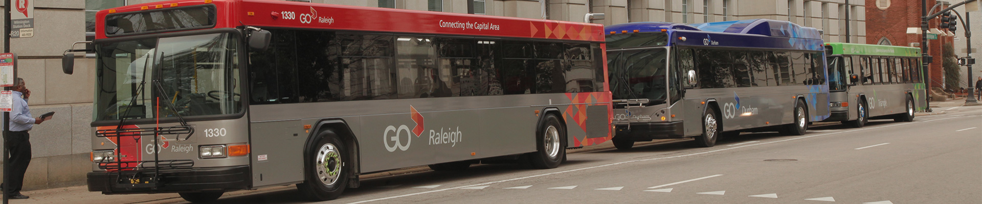 A GoRaleigh bus, a GoDurham bus and a GoTriangle bus parked next to each other