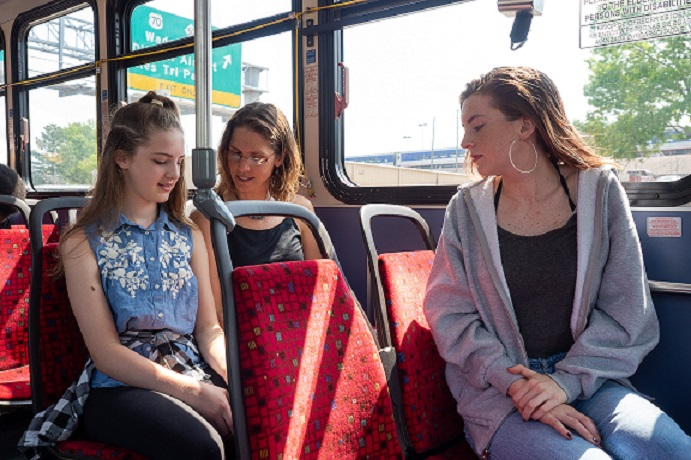 Raleigh artist Autumn Cobeland rides a GoRaleigh bus with her daughters Maya and Tess from their home in Five Points to downtown Raleigh. The family decided to dump one of its cars a few years ago.