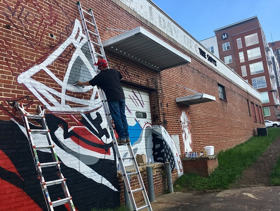 Carolina Hurricanes mural overtakes GoTriangle building in Raleigh.